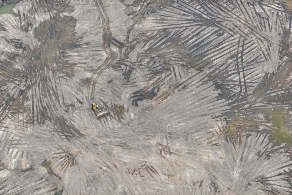 the-earth-above-the-bitumen-known-as-overburden-must-be-completely-removed-including-all-trees-plants-or-other-natural-elements-in-order-to-access-the-oil-underneath