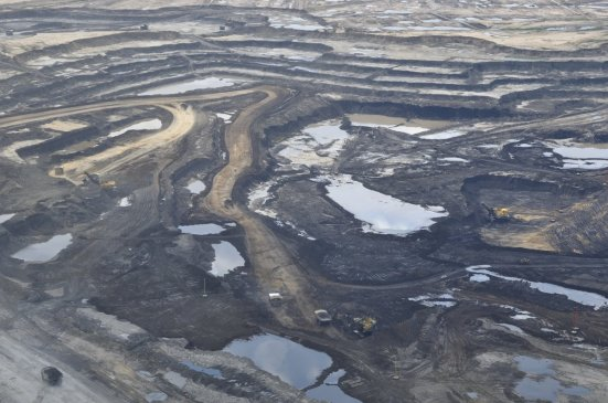 there-are-two-main-ways-to-extract-oil-from-the-oil-sands-one-way-known-as-open-pit-mining-extracts-the-bitumen-oil-which-is-closer-to-the-surface-of-the-earth-buy-removing-the-soil-above-it