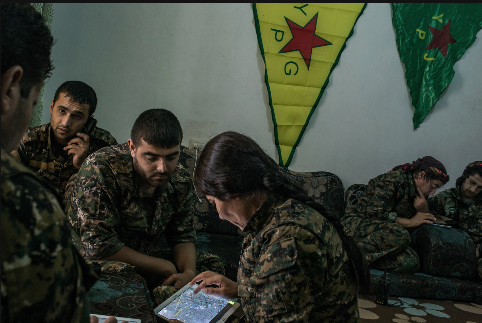 Kurds checking targets on tablets' maps to determine where Ameican combat missions may strike
