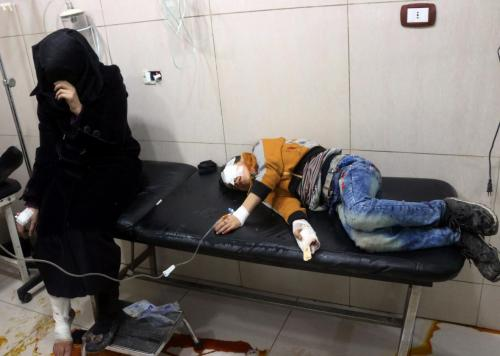 624143740-graphic-content-wounded-syrians-are-seen-on-a-table-in_1-jpg-crop-promo-xlarge2