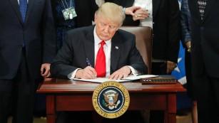 170125134602-01-trump-executive-order-immigration-0125-medium-plus-169