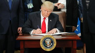170125134602-01-trump-executive-order-immigration-0125-medium-plus-169